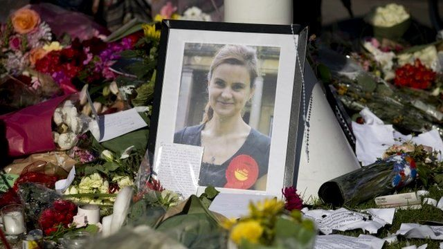 A photograph of Jo Cox stands amongst tributes laid in her memory in Parliament Square, London