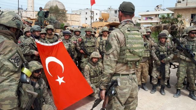 Turkish soldiers stand in crescent form in town center after Turkish Armed Forces and Free Syrian Army (FSA) took complete control of northwestern Syria's Afrin within the 'Operation Olive Branch' on March 18, 2018. 'Afrin town center was completely taken control of at 8.30 a.m