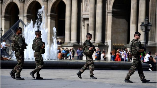 Soldiers patrol around the Louvre Museum in Paris on 10 September 2016.