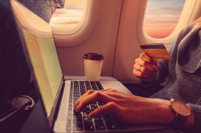 Woman buying flight tickets online