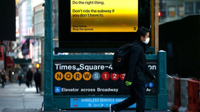 A man passes by a Times Square subway station 42nd street as New York City attempts to slow down the spread of coronavirus through social distancing on April 1, 2020