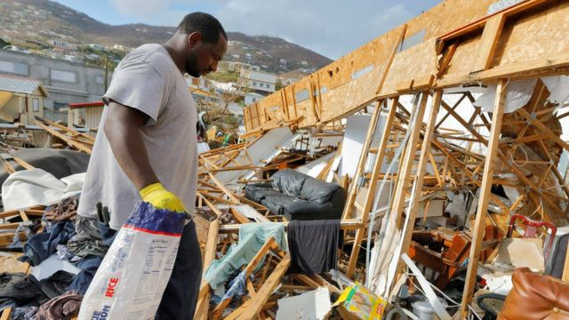A resident of the Frenchtown district walks through the debris of his home 12 days after Hurricane Irma wrought havoc to the island, in Charlotte Amalie, St. Thomas, U.S. Virgin Islands