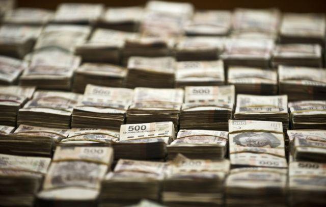 O milhão de dólares e os 41 milhões de pesos apreendidos com Eric Jován Lozano Díaz, suposto membro dos Zetas