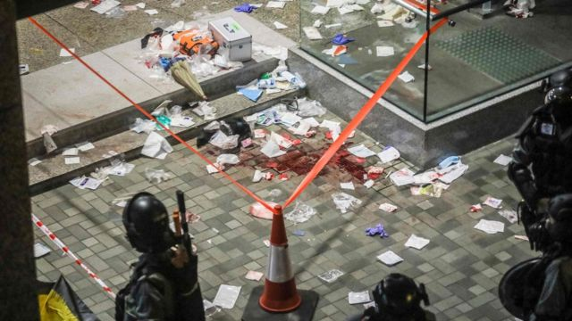 Blood and debris are seen on the ground at the entrance of a shopping mall after a bloody knife fight broke out in Hong Kong on November 3, 2019.