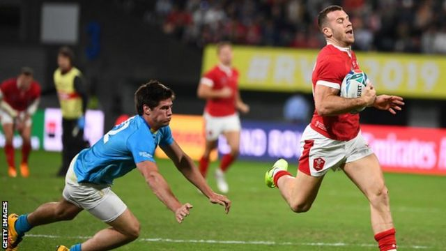 Wales replacement Gareth Davies runs past Uruguay's centre Tomas Inciarte to score a try