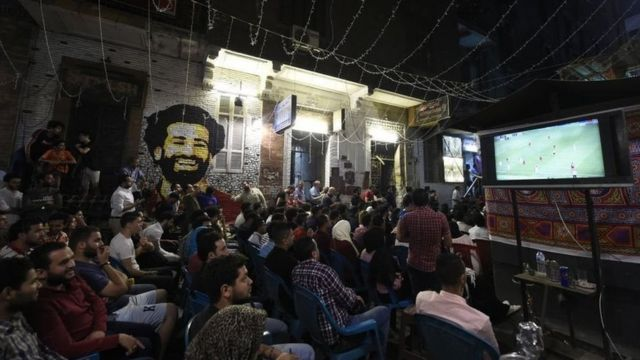 Egyptian fans watch the 2019 UEFA Champions League final on a Cairo street