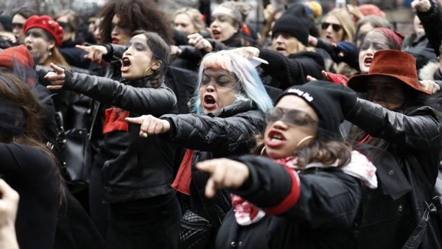 Women with blindfolds performing during a protest on 10 January