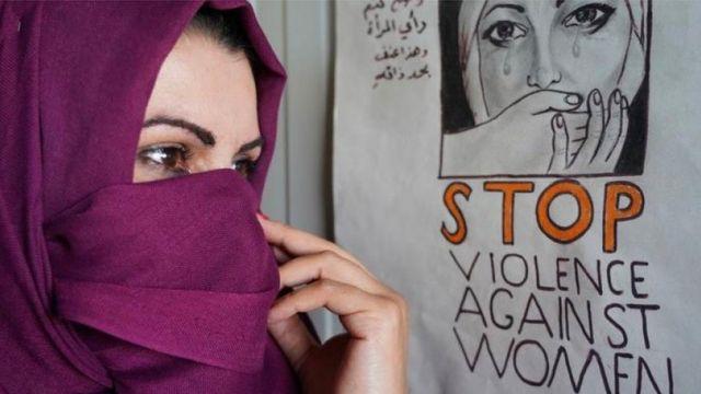 ملصق ضد العنف الأسري في العراق
