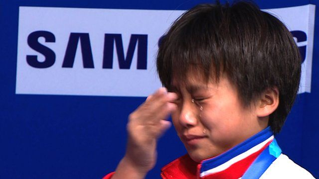 North Korea's Kim Kuk Hyang has an emotional reaction to her 10m platform dive win