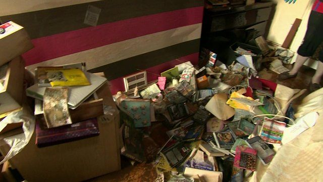 Damaged belongings on lounge floor
