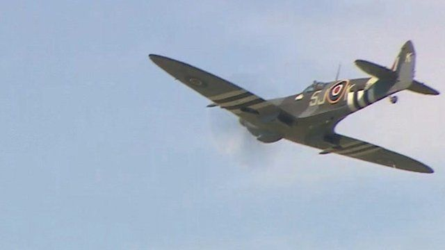 A Spitfire plane flying over London
