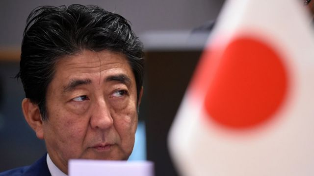 Japan's Prime Minister Shinzo Abe looks on ahead of a Asia Europe Meeting (ASEM) at the European Council in Brussels on October 19, 2018.