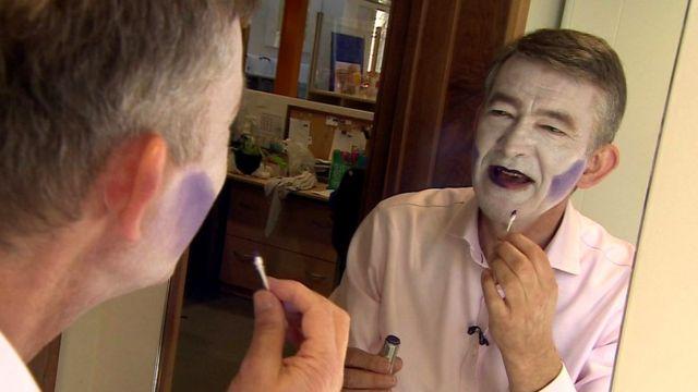 Nick Higham putting on make-up