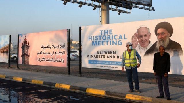 Плакат с портретами папы римского Франциска и великого аятоллы Али Систани