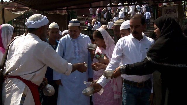 Indian bhishti distributing water
