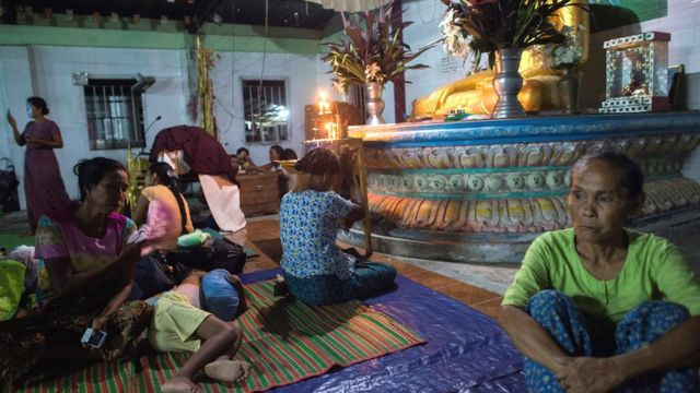 Ethnic Rakhine people praying in a Buddhist temple