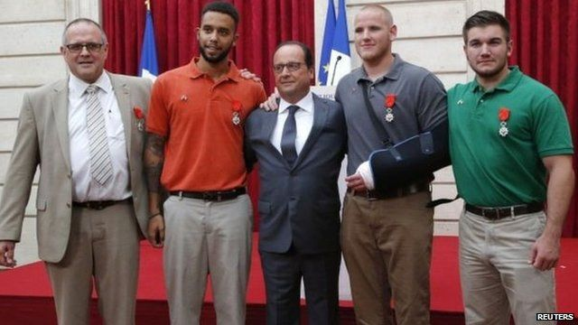 "Mr Hollande (C) said of Chris Norman, Anthony Sadler, Spencer Stone and Alek Skarlatos: ""You gave us a lesson in courage"""