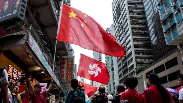 Pro-China protesters wave the Chinese and Hong Kong flags during a pro-government rally on that island.