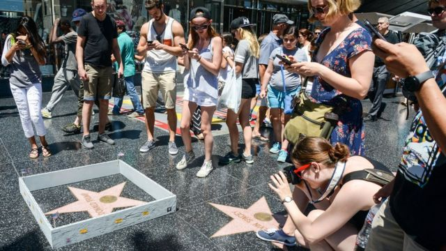 US election: Artist builds wall around Trump's Hollywood star