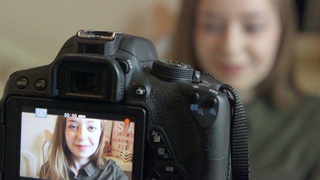 Vlogger Anastasia looking into a camera