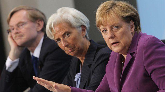 Merkel e a diretora do FMI, Christine Lagarde