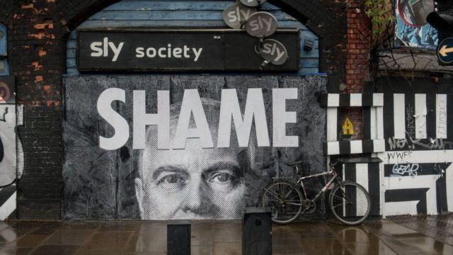 Граффити с лицом Эндрю в лондонском районе Шордитч.