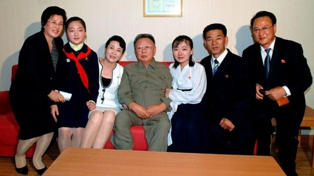 A family taking a photo with Kim Jong-il