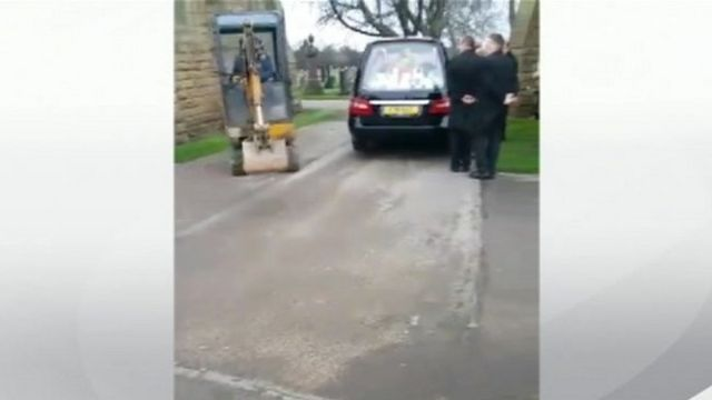JCB and hearse