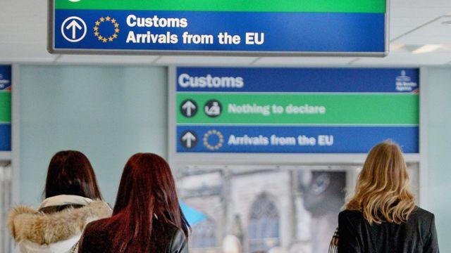 Immigration and border control signs at Edinburgh Airport on February 10, 2014 in Edinburgh, Scotland.