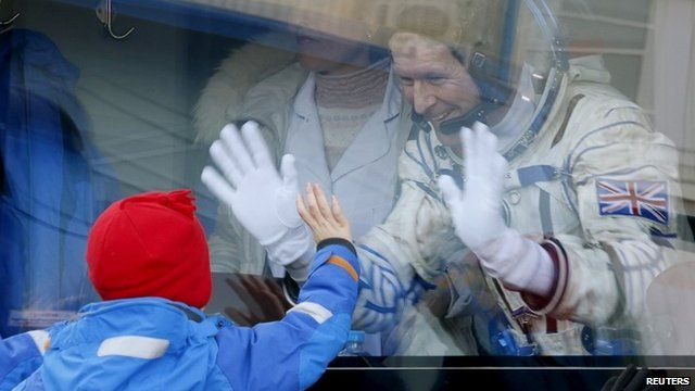 British astronaut Tim Peake waves to his children