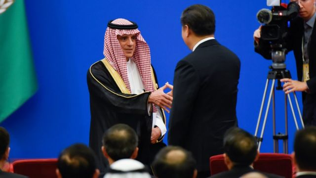 Xi Jinping and the Saudi Foreign Minister, Adel al-Jubeir.