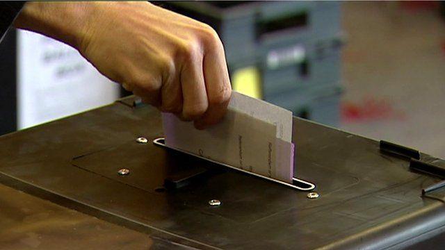 Voting slip into ballot box