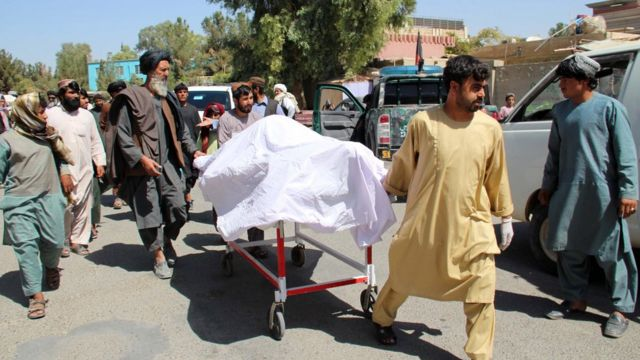 People move the bodies of their relatives who were killed in an air raid and ground assault on a Taliban hideout by Afghan special forces, in Helmand, Afghanistan, 23 September 2019.