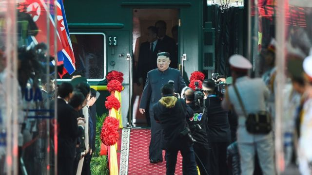 "North Korea""s leader Kim Jong Un (C) arrives at the Dong Dang railway station"