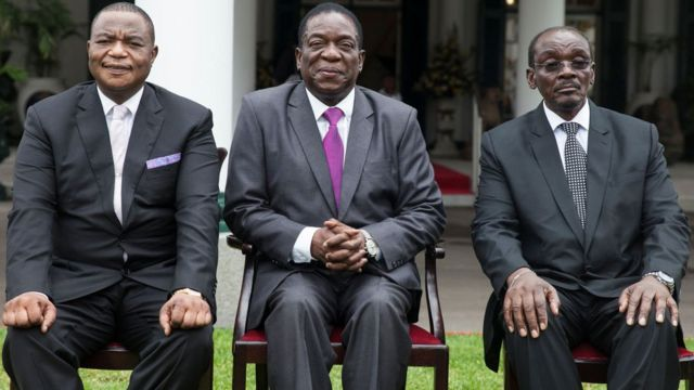 (From L) Zimbabwes former army commander and newly appointed vice president General Constantino Chiwenga, Zimbabwe's president Emmerson Mnangagwa and Zimbabwes newly appointed vice president Kembo Mohadi