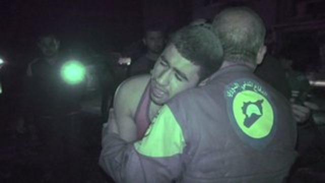 Distressed man being comforted by rescue worker
