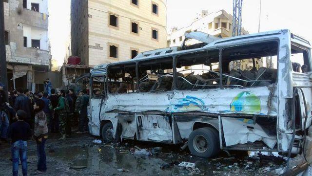 Syrians gather where three bombs exploded in Sayyida Zeinab, Syria (31 January)