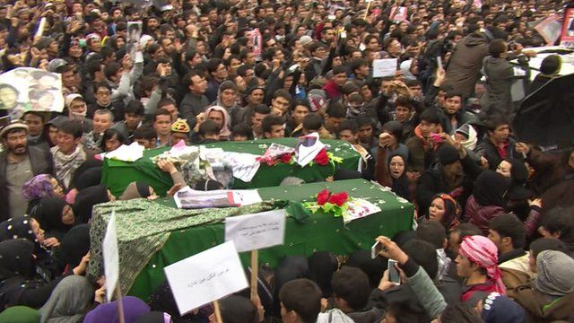 Protesters carry the coffins of the Hazara citizens killed