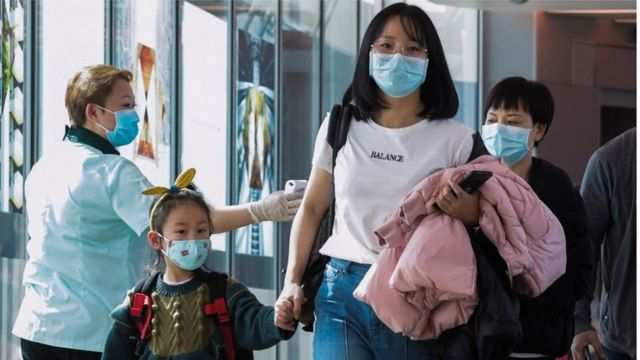 arriving passengers from China at Changi International airport in Singapore on January 22, 2020
