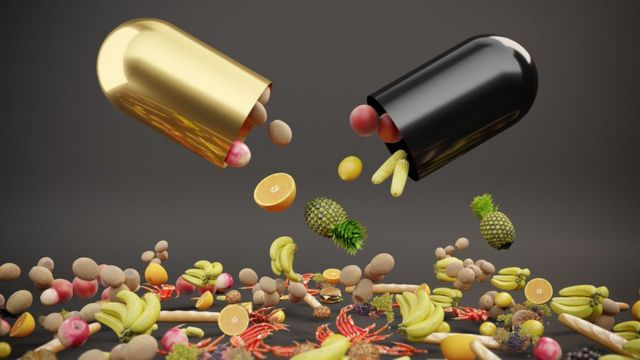 Ilustração mostra duas cápsulas com imagens de frutas e verduras caindo