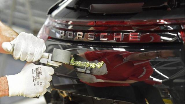 Mechanic polishing Porsche car