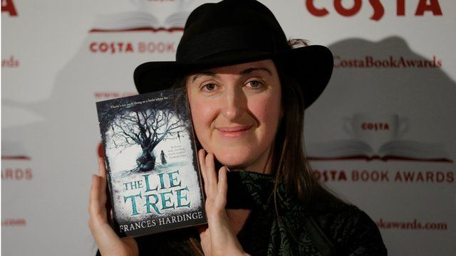 Frances Hardinge poses for photographs with her book 'The Lie Tree'