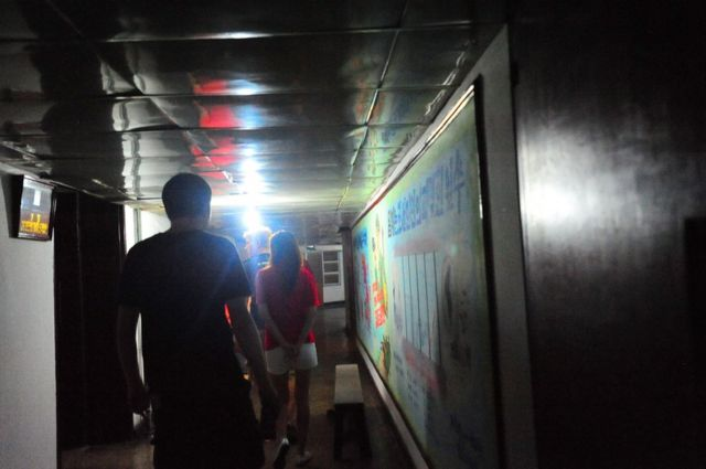 Walking down the low ceiling 5th floor corridor