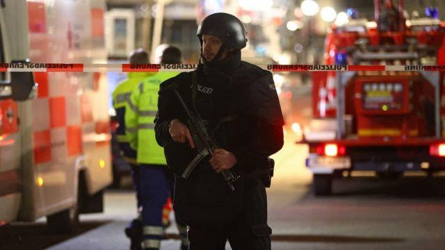 Polisi di lokasi penembakan.