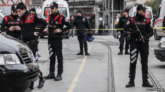 Police secure the area following a suicide bombing in a major shopping and tourist district