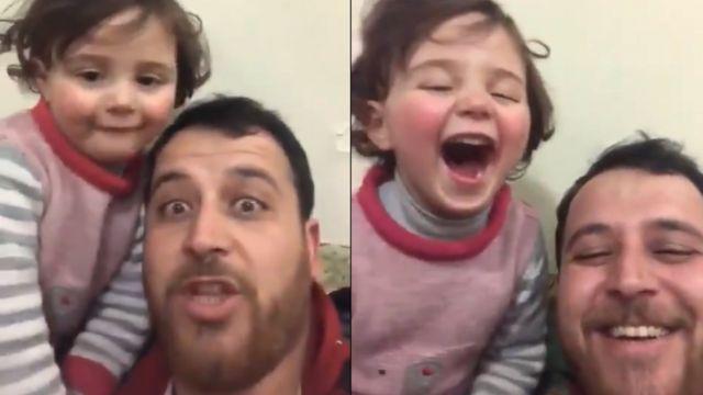 أب سوري وابنته يضحكان على صوت القذائف