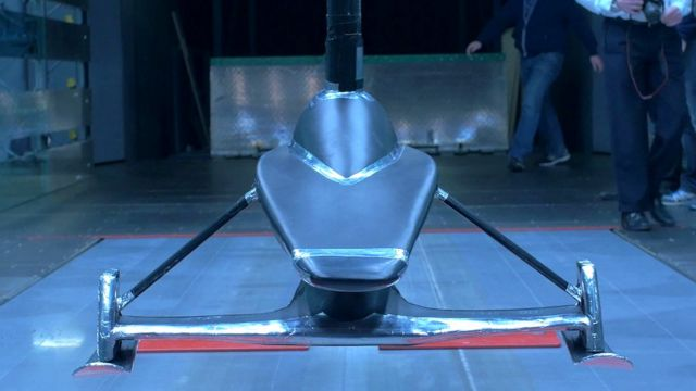 A scale model of a gravity-powered snow sledge, designed to beat the world speed record.