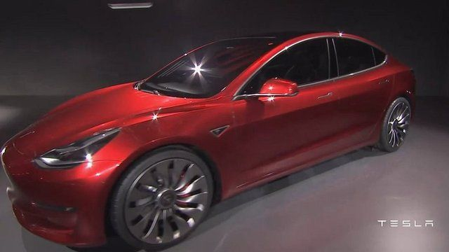 Tesla Reveals Model Electric Car Bbc News