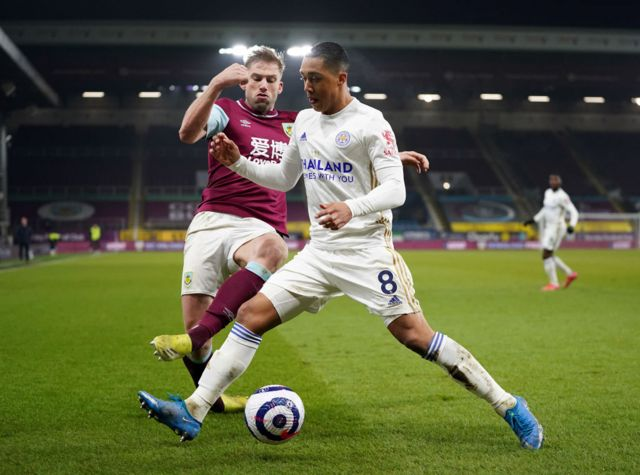 Burnley's Charlie Taylor and Leicester City's Youri Tielemans