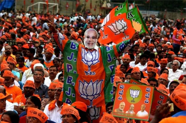 A general view showing BJP supporter wearing a mask of Indian Prime Minister Narendra Modi is seen during the Bhartya Janta Party (BJP) public rally meeting ahead of Karnataka Assembly Election, in Bangalore, India, 08 May 2018.